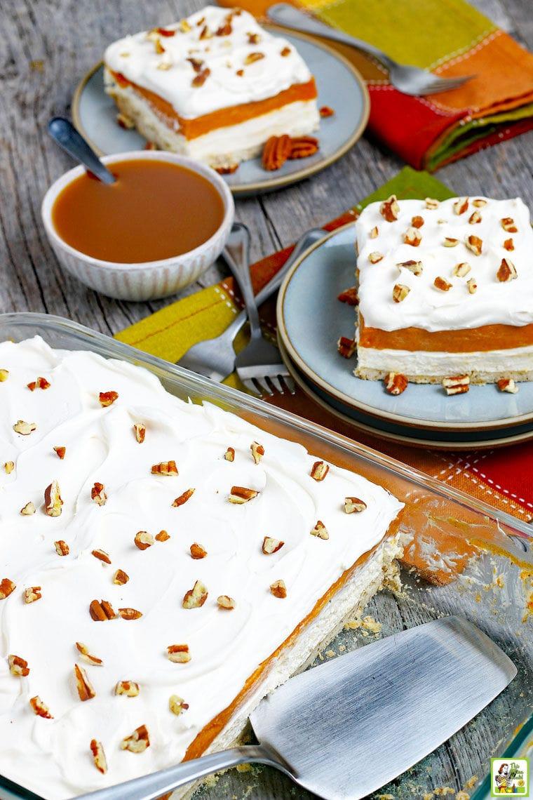 Plates and a baking dish of Pumpkin Cheesecake Lasagna.