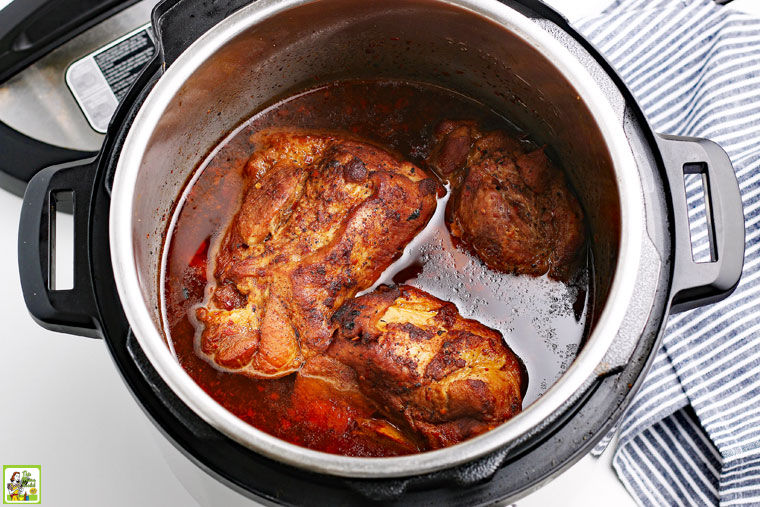 Cooked pieces of pork in the pressure cooker.