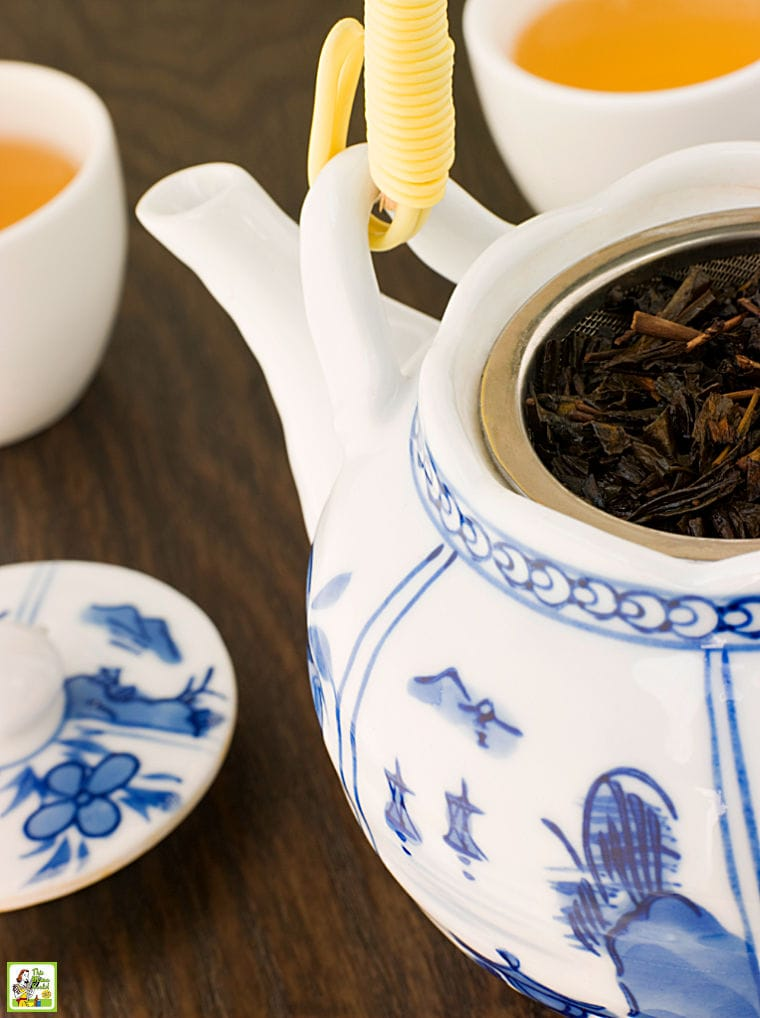 Green tea in an Asian porcelain tea pot and tea cups.