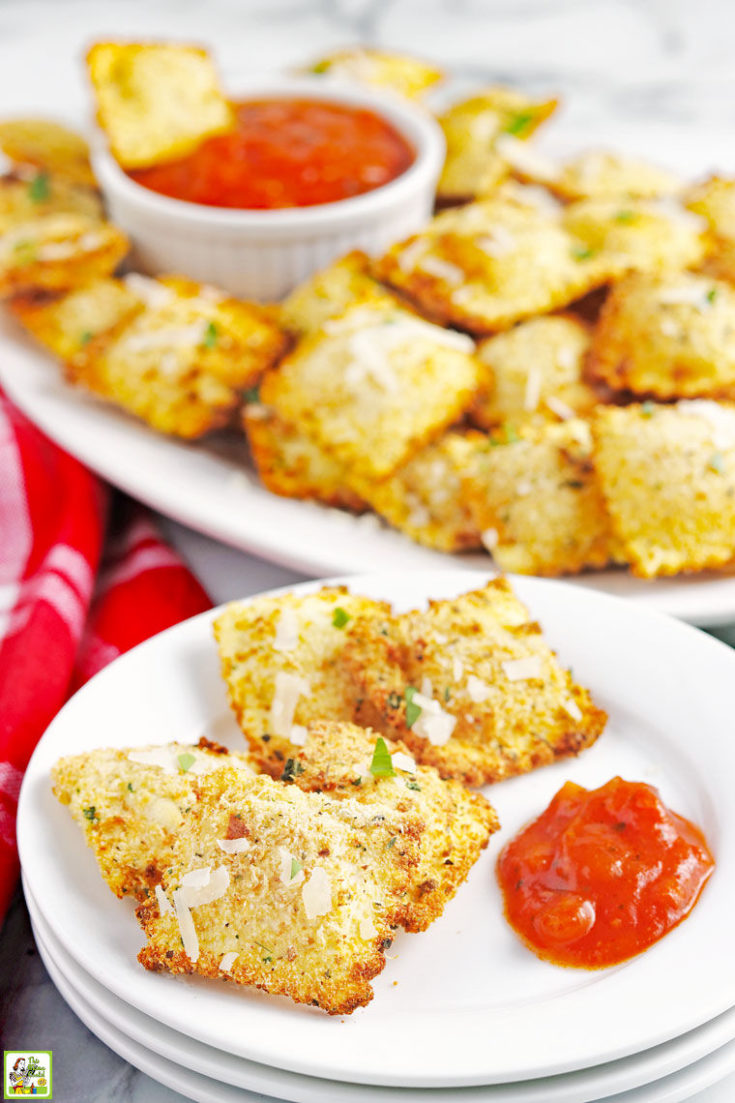 A plate and platter of air fryer ravioli appetizers with red cloth napkin.