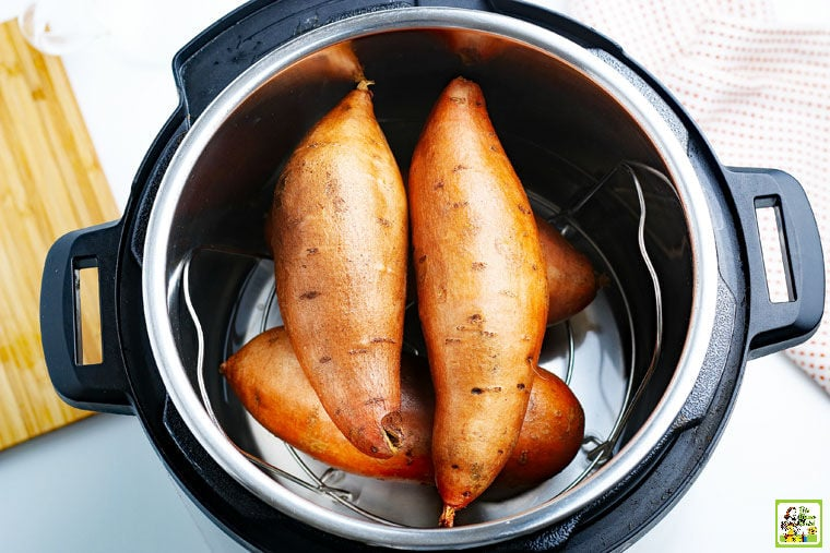 Cooking a stack of sweet potatoes in a pressure cooker Instant Pot.