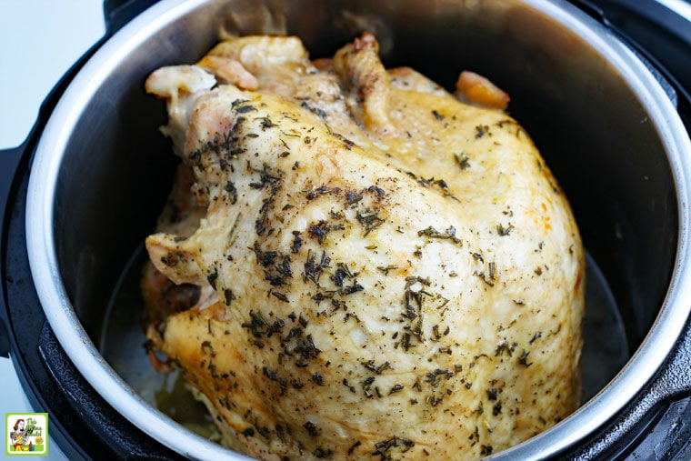 A whole cooked chicken in an pressure cooker Instant Pot.