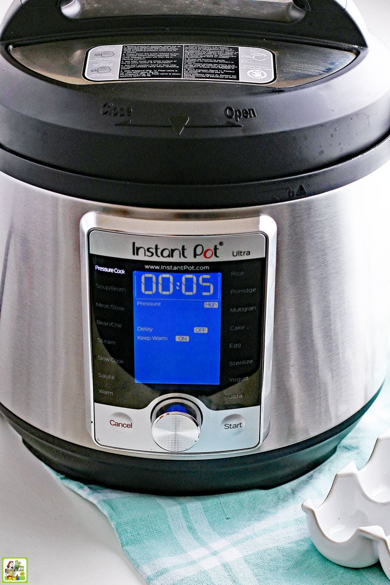 An Instant Pot Pressure Coooker on a light blue dish towel.