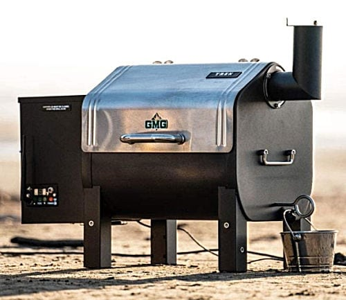 A black and silver Green Mountain Trek WiFi Controlled Portable Wood Pellet Tailgating Grill with side smoker box and chimney.