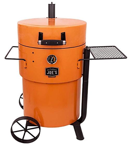 An orange barrel shaped Oklahoma Joe's 19202100 Bronco Pro Drum Smoker.