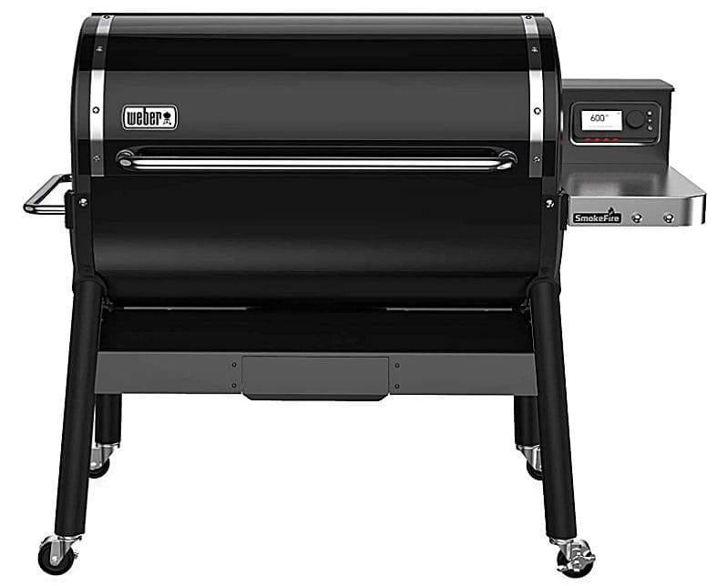 A large black Weber SmokeFire EX6 (2nd Gen) Wood Fired Pellet Grill with wheels.